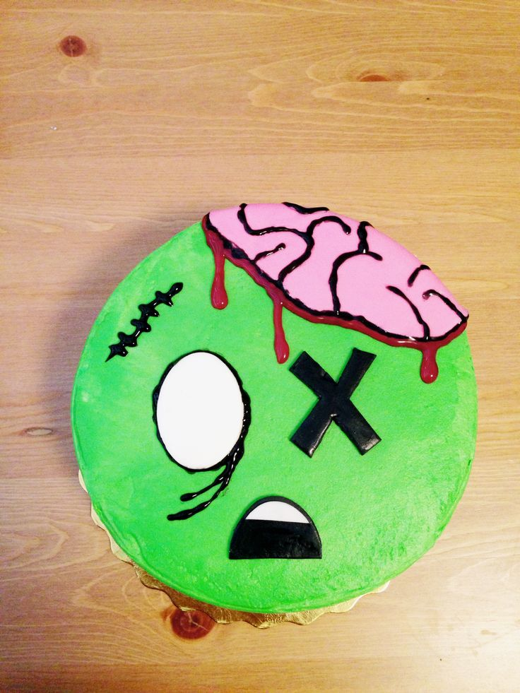 Zombie cake for my son's 5th birthday party, store bought cake decorated by me with homemade marshmallow fondant and gel icing.