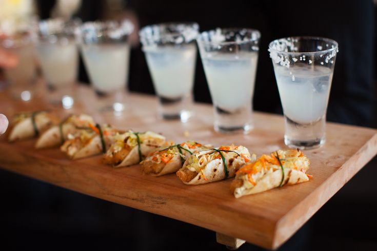 A Whimsical Wedding Needs Whimsical Appetizers: Mini-Fish Tacos and Margarita Shooters! See more on SMP: http://www.StyleMePretty.com/canada-weddings/2014/02/06/steam-whistle-brewery-wedding/ Root Photography