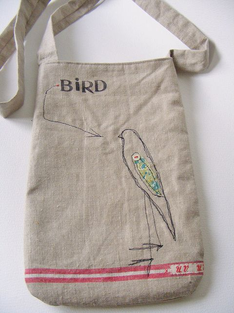 handmade shoulder bag with free machne embroidered bird. Hand stamped text.