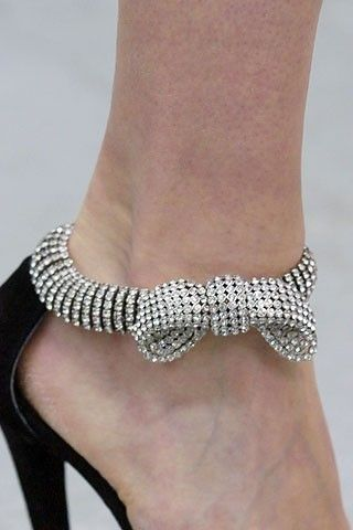 A bow elegantly tied around a lady's ankle makes any other jewelry unnecessary.