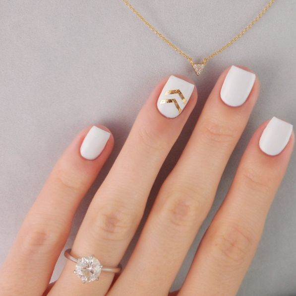White nails with gold details