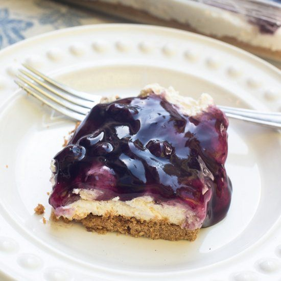 Easy Blueberry Cheesecake Dessert is a tasty, make-ahead dessert that is perfect for a large gathering. Creamy, light, and delicious!