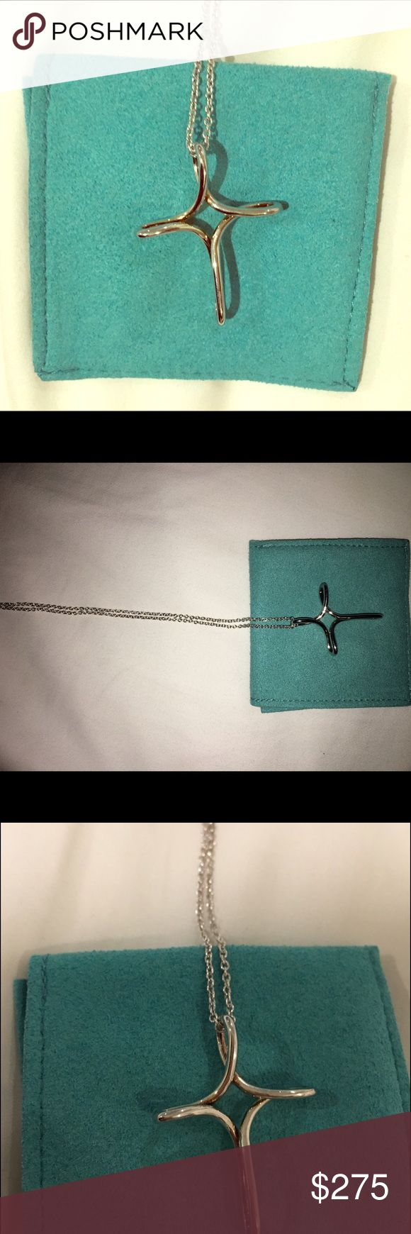 Tiffany & Co Elsa Peretti Infinity Cross Necklace beautiful never worn sterling silver cross necklace, 100% authentic and comes with original dust bag Tiffany & Co. Accessories