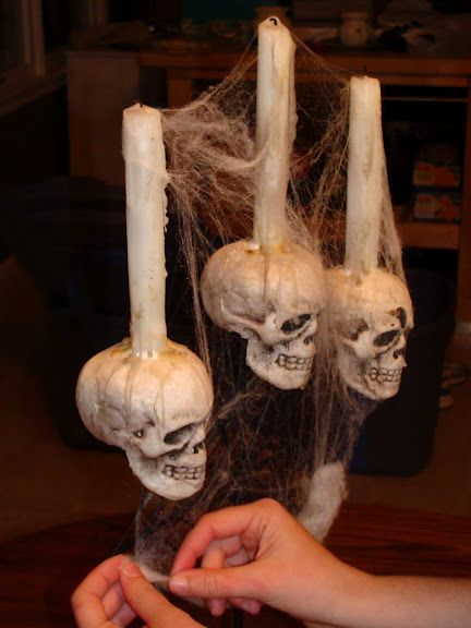 DIY: Spooky Halloween Candelabra. Dollar store skulls! I actually have some of these!!