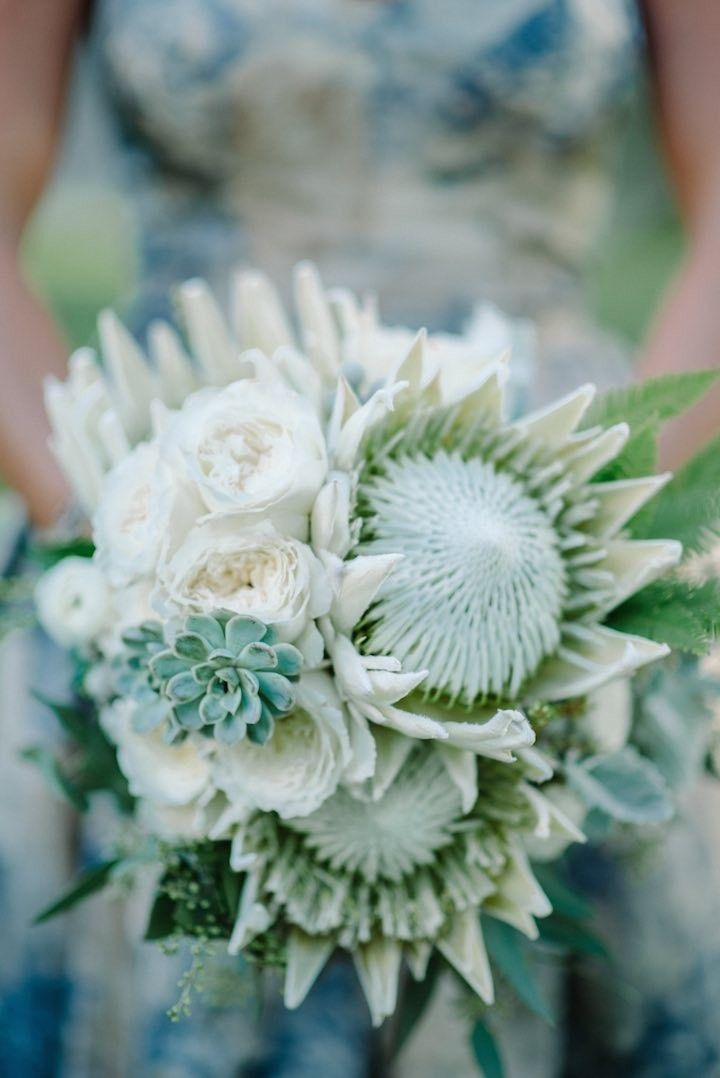 Stunning wedding bouquet with cool color; photo: Sean Money + Elizabeth Fay
