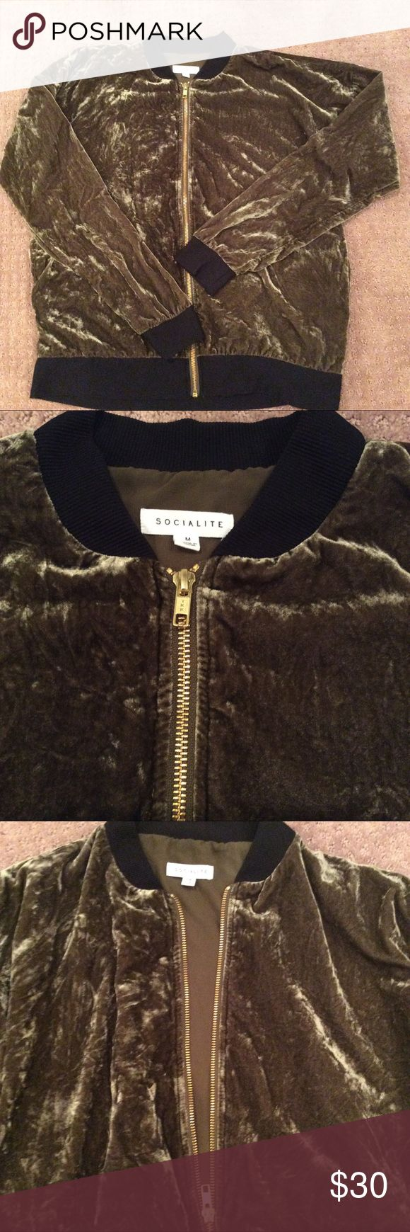 """Crushed velvet army green bomber jacket On trend, goes with everything. Lightweight. Gold zipper, black ribbed waist and cuffs. Loose fitting. Bottom waist band is 20"""" flat. Across chest is 22"""" flat. Shoulder to waist is 24"""". Would definitely work for a larger size. 2 side pockets. Socialite Jackets & Coats"""