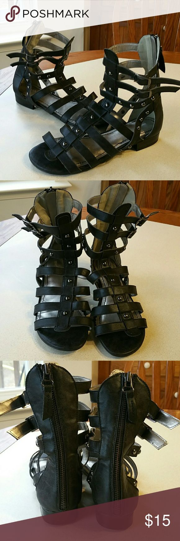 JUST IN. Faux leather gladiator sandals.NWOT sz 7 Cute, new, never worn. No box. Zippers up the back. Size 7. Man made faux leather. Lots of cute pewter studs on straps. Great for summer!! Boutique Shoes Sandals