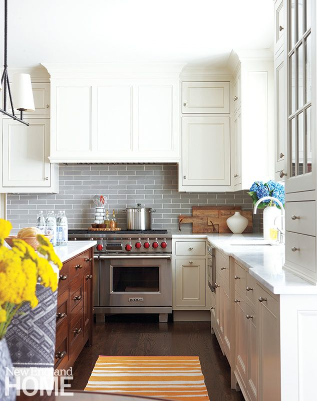 Gray tile from Waterworks makes for a sophisticated backsplash below custom cabinets painted in Farrow & Ball's popular Clunch. A walnut island provides warm contrast with the marble counters. Interior design, Carey Karlan, Photography, Michael Partenio Evolution from Within | New England Home Magazine