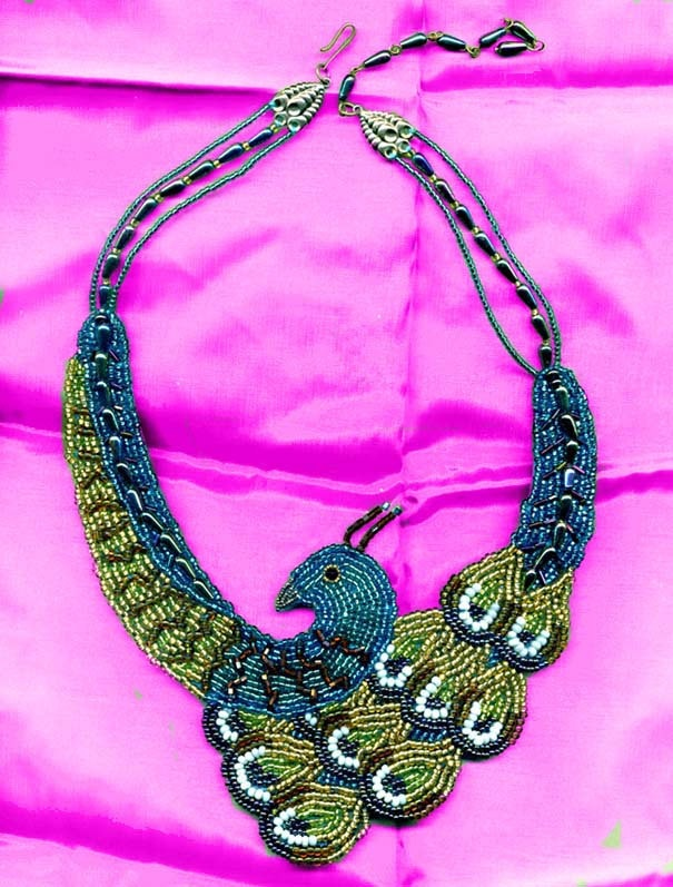 Peacock Bead Embroidered Necklace. €200,00, via Etsy.