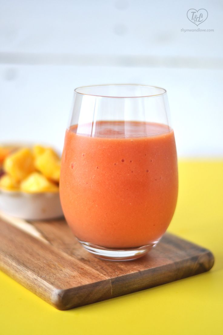 Healthy + Easy Strawberry Mango Smoothie with citrus and ginger is a healthy way to start your morning! #smoothie #breakfast #vegan