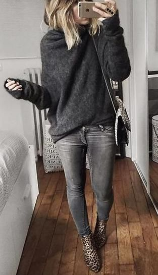 Grey skinny jeans, grey slouchy jumper and animal print ankle boots.