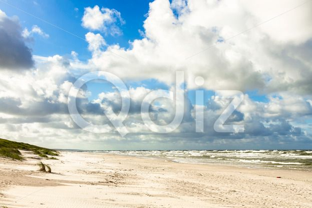 Qdiz Stock Photos | Sand beach on Baltic sea,  #Baltic #beach #blue #clouds #coast #coastline #curonian #destination #Europe #horizon #landscape #Lithuania #location #nature #neringa #nida #outdoor #sand #sandy #sea #seascape #shore #sky #spit #surf #Travel #vacation #view #water #waves #way #wildlife