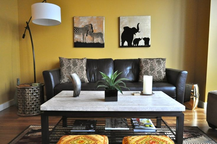 African themed living room with fireplace african themed for Safari themed living room ideas