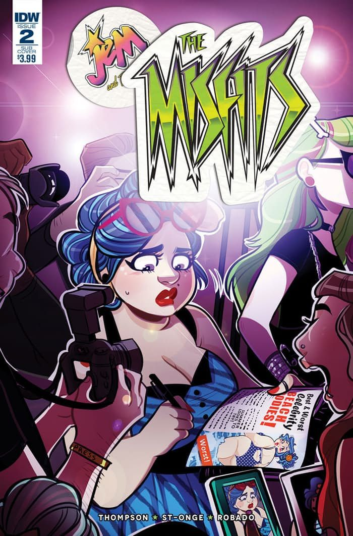 """http://www.cbr.com/idw-publishing-solicitations-for-january-2017/   Cover above by Jenn St-Onge   Jem: The Misfits #2      Kelly Thompson (w) • Jenn St. Onge (a & c) • M. Victoria Robado © • Derek Charm (var)     OUR SONGS ARE BETTER Part Two! The band is getting a whole new taste  of fame via an intrusive """"MISFITS!"""" reality TV show and it's pushing on  everyone's most vulnerable buttons – none more so than Stormer — who's  reliving her early days of fame and the nasty..."""