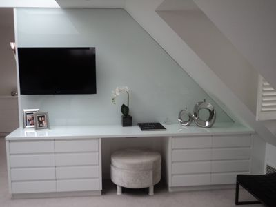 White High Gloss Dressing Table Backing onto Wardrobes With A Glass Top
