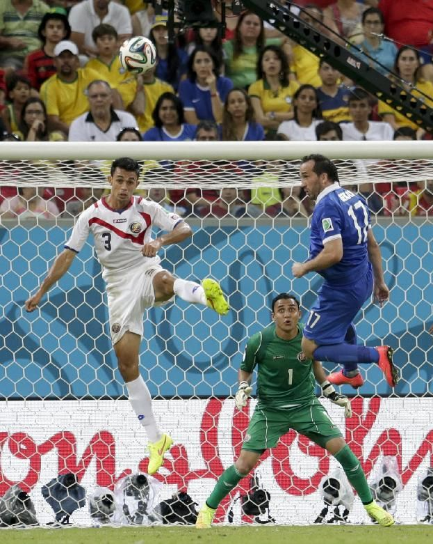 Costa Rica's goalkeeper Keylor Navas watches as Giancarlo Gonzalez (3) clears the ball in front of Greece's Fanis Gekas during the World Cup round of 16 soccer match between Costa Rica and Greece at the Arena Pernambuco in Recife, Brazil, Sunday, June 29, 2014.
