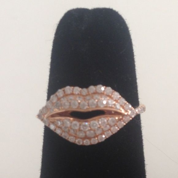 18 Karat Rose Gold Diamond Lips Ring. NWOT This stunning ring was purchased at the famous jewelry store in Beverly Hill XIV KARATS LTD. A Beverly Hills institution,  XIV Karats is the place locals and celebrities alike get there fabulous diamonds! The list is to long to name all the celeb and fashion cognoscenti that have shopped here.   This fabulous and oh so stylish Diamond Lips Ring features:  • 18 Karat Rose Gold Ring • Ring contains 68 round cut diamonds  • Weight 0.51ct  • Size 6…
