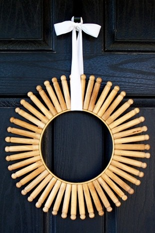 Wooden clothes pin embroidery hoop wreath. You could even paint or stain the clothes pins. For a mirror, perhaps.