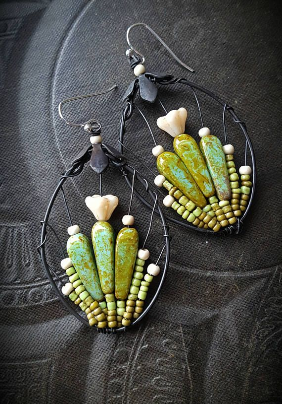 100 % Artisan Made; wire wrapped glass flowers, stems and rounds of howlite mixed with glass seed beads to form a bursting blooming cactus garden, finished off with sterling silver ear wires • very light weight!!!!!!!!!!!!!! • never to be duplicated exactly • totally unique • 100% ARTISAN HANDMADE!! • Yucca Bloom original