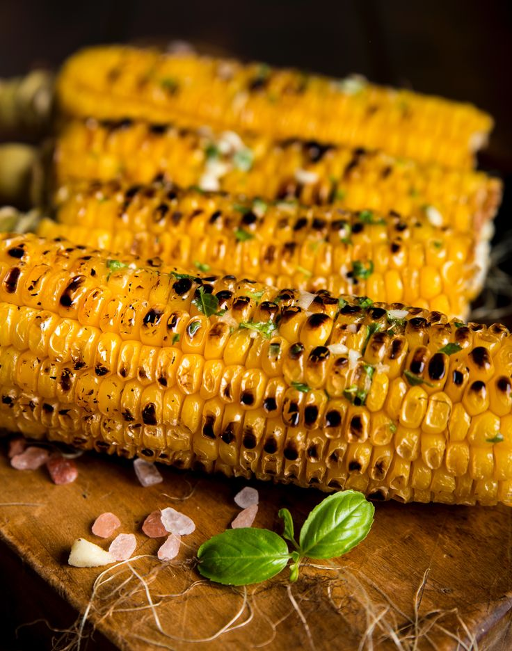Flavored-butter grilled corn?  Fill a grilling basket with some corn,brush it generously with butter, latch the lid into place and wait for that sizzling to start spreading some great flavors.
