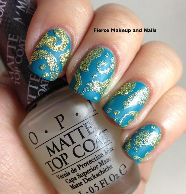 Matte Topper With Swirls Of Glue Lied And Loose Glitter Sprinkled Over The That Are