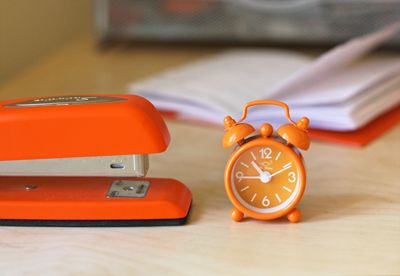 Orange accessories from How About Orange.  I just love the little alarm clock.