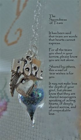 Unique sympathy gifts can be as small as a wishing vessel that holds holographic glitter - symbolic of tears that are shed by all who know the grief of losing a loved one. Not quite 1 1/2 inches in size, this tear hangs by a lovely heart-link chain and comes with this heartfelt verse. (view the store page). A great condolence gift.