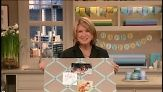 Martha Stewart attaches fabric and ribbon to a board of pressed paper to make her most popular Good Thing, a  ribbon bulletin board.