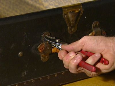 nk. Use a tape measure to locate the nail point on the inside of the trunk lining, then tap it loose with a nail-punch and hammer. As each nail head pops out on the outside of the trunk, grasp it with a pair of pliers and pull it through.