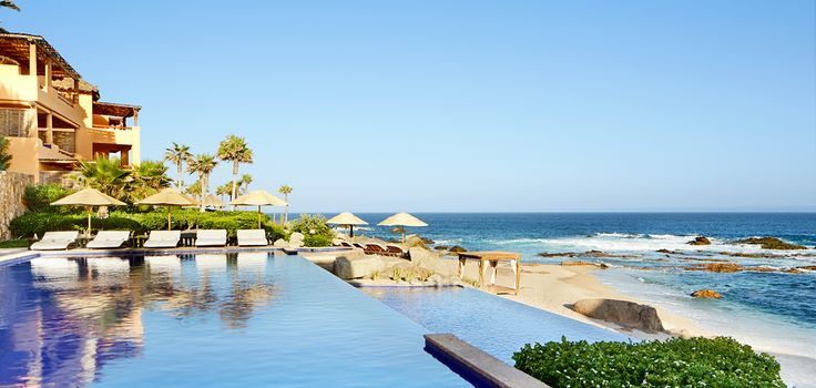 Would you lounge by the pool or sit on the beach first at the Esperanza Resort in Cabo San Lucas?