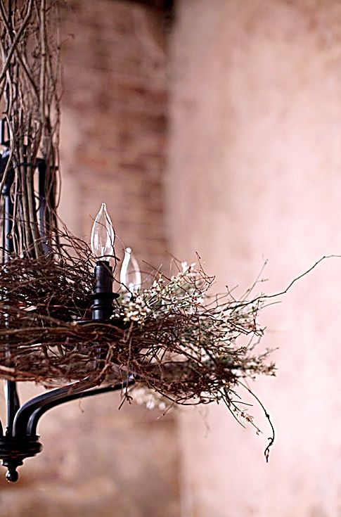 Spring Chandelier Decor ~ Love the use of baby's breath and intertwined vines.