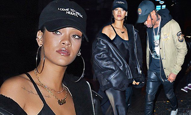 Rihanna sizzles in sultry slip dress as she parties with Travis Scott