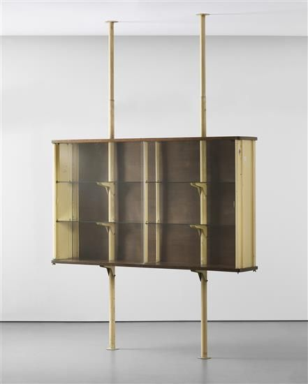 JEAN PROUVÉ Suspended cabinet, designed for Ferembal House, Nancy, 1948  Painted steel, painted tubular steel, oak, glass. Cabinet: 45 7/8 x 77 1/2 x 13 5/8 in (116.4 x 196.7 x 34.7 cm); installation height variable Manufactured by Les Ateliers Jean Prouvé, France