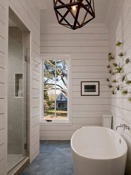 farmhouse bathroom by Bevan Associates -- love the wall paneling, penny rounds, and modern bath tub