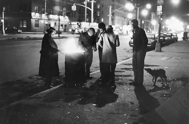 A Group Of Homeless Men Stand Around A Fire In An Oil Drum On The Homeless Man Oil Drum New York January