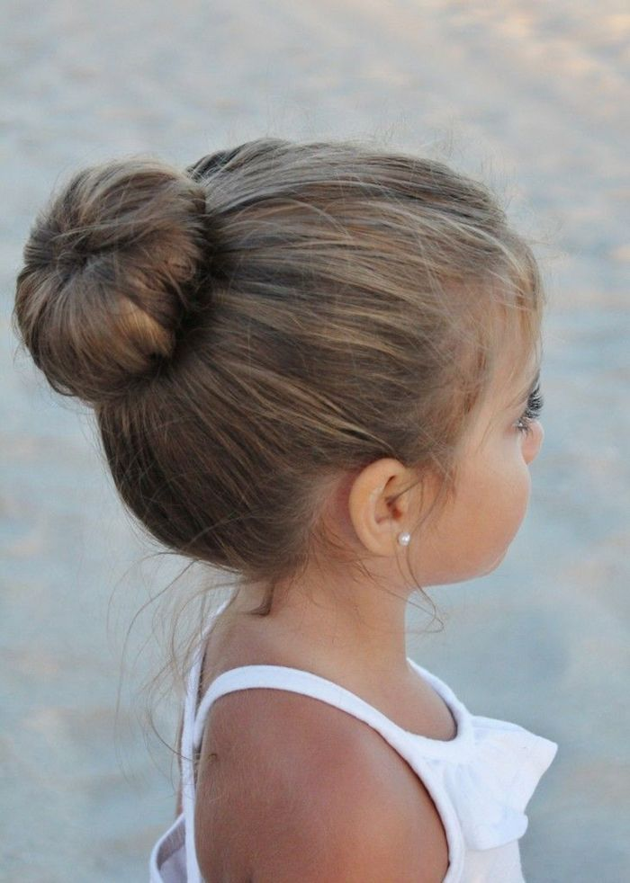 Ballerina Hair Bun On The Head Of A Small Brunette Child Cute Hairstyles Wearing A Little Girl Hairstyles Cute Little Girl Hairstyles Flower Girl Hairstyles