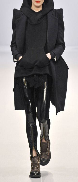 Extraordinarily savvy use of textures to mix casual ease with sharp and shiny. Kangaroo pouch/hoodie/shoes vs bold shoulders/patent leggings. Yet this steals my heart.