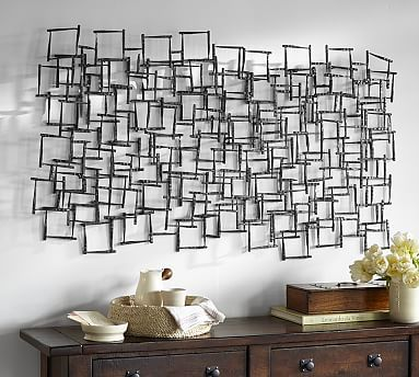 Forged Metal Sculpture // This sculpture has a delicacy that belies its iron construction. The overlapping squares create intriguing shadows on the wall.