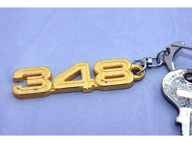 Keychain with the Ferrari 348 logo. You can see it and buy it at https://www.shapeways.com/shops/308bits?section=Automobilia&s=0