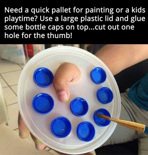 Art set up for kids using a lid and bottle tops.