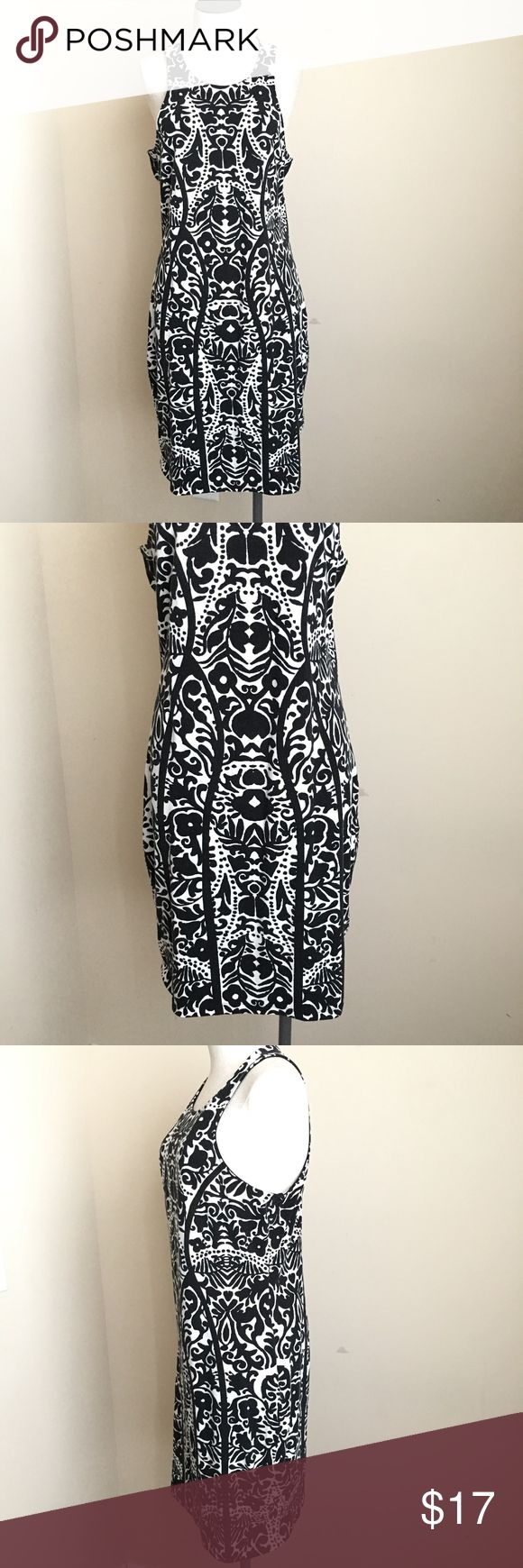 """H&M Stretch Bodycon Printed Zip Up Racerback Dress H&M Stretch Bodycon Printed Zip Up Racerback Dress  Black and white print  Womens size Large  95% Cotton and 5% Elastane  The black pattern has some wash wear to the color  Measurements taken while laying flat:  19"""" armpit to armpit 17"""" length  36"""" waist  Pair this dress with a bold colored chunky statement neck H&M Dresses"""