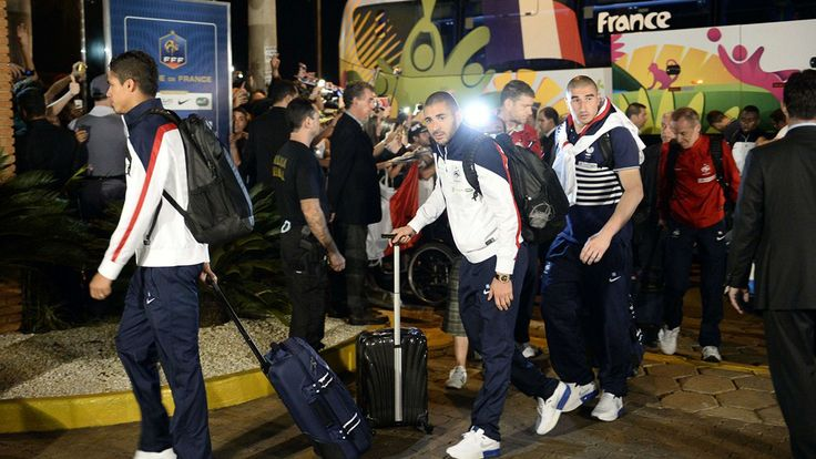 France's defender Raphael Varane, forward Karim Benzema and goalkeeper Stephane Ruffier arrive at the JP Hotel, which will host the French national football team during the FIFA World Cup Brazil 2014, in Ribeirao Preto