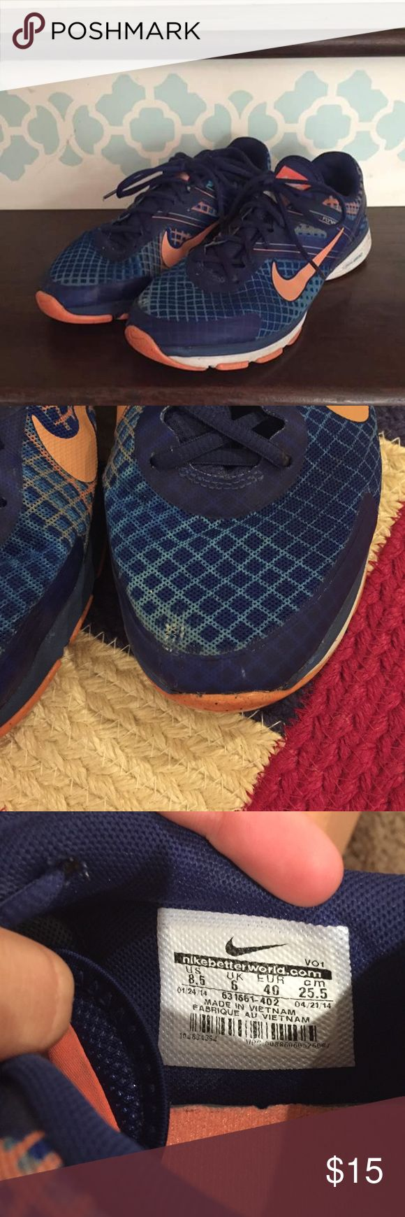 Women's Nike Dual Fusion Flywire size 8.5 These are blue and orange women's Nike shoes. They're in good condition with one minor flaw. There is a tiny part on the left shoe where the material is thin. Other than that they're perfect! Nike Shoes Athletic Shoes