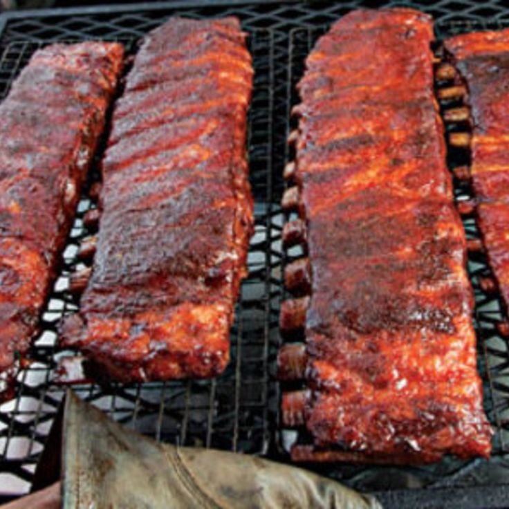 """George """"Tuffy"""" Stone of A Sharper Palate catering in Richmond, Virgina, developed this recipe for ribs using his 3-2-1 method: cooking for three hours unwrapped, two hours wrapped in foil, and another one unwrapped. This recipe first appeared in our June/July 2011 BBQ issue along with Dana Bowen's story The Winner's Circle."""