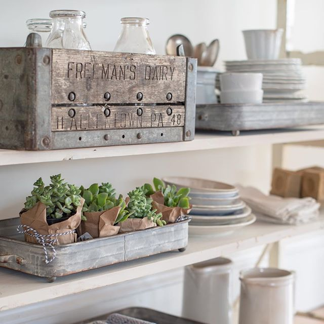 I'm don't usually go crazy about crates, but I did over this milk crate. The carved lettering and patina on the wood and metal are just perfect. #favoritefinds #farmhousestyle #antiques #mmsstudio