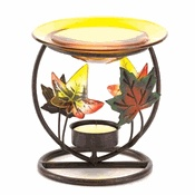 "Pay homage to fall's breathtaking beauty with this decorative designer treasure!  Colorful leaves brighten the base below a golden glass dish; just add a tealight and a few drops of oil, then relax and enjoy its warming glow.    Weight 0.4 lb. Metal, glass and plastic.  Oil and tealight candle not included.  Dimensions: 4 1/2"" diameter x 4 1/2"" high."