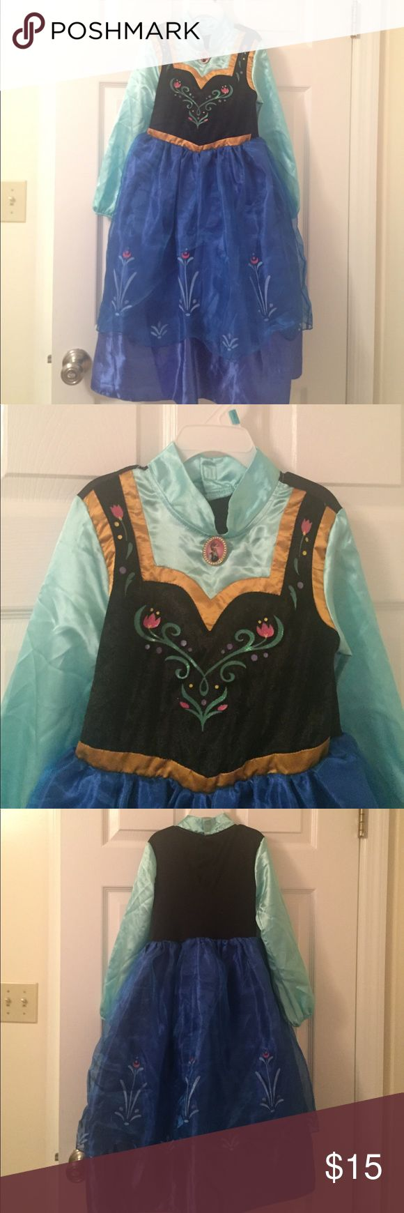 Girls Costume Disney's Frozen Ana Costume. Size 5/6. Good condition. Worn twice. Costumes Halloween