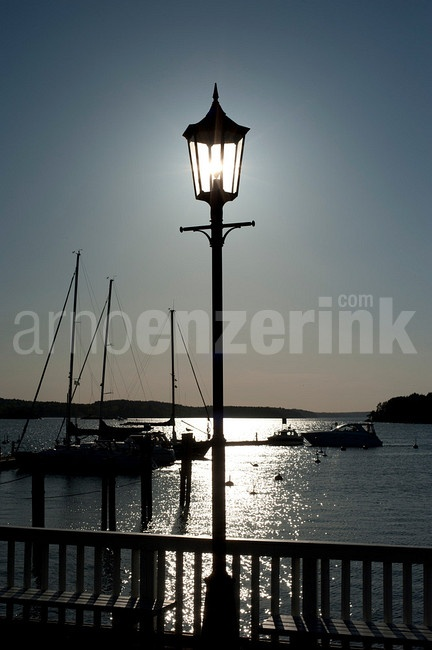Sun lighting up a street lamp  © Arno Enzerink / www.stockphotography.nu All rights reserved.
