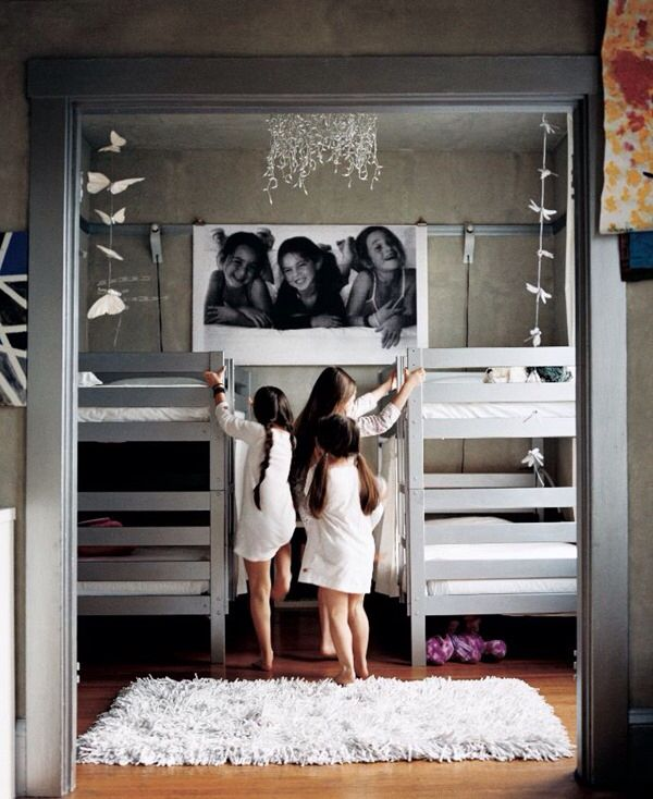 Love the photo poster between the beds