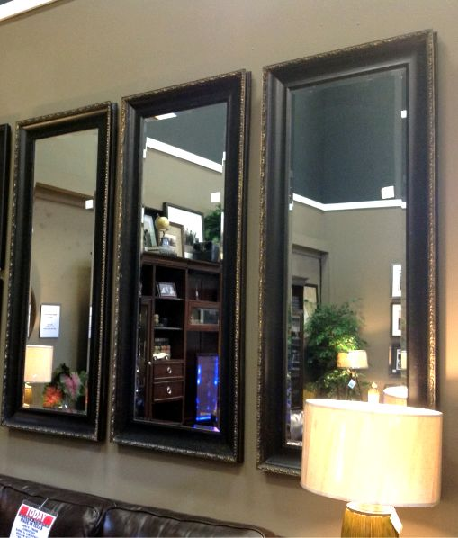 mirrors together to create a big statement on your living room walls